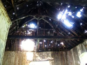 Deteriorating roof of vat building.