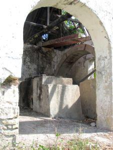 View of waterwheel through door of machinery building.