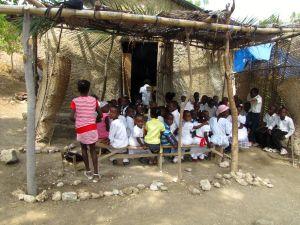 Children seated behind church