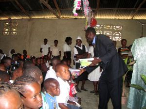 Pastor Job handing out gifts.